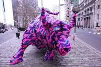 This was pretty famous - artist Olek put on some cloths on New York Stock Exchange bull on Wall Street, USA.